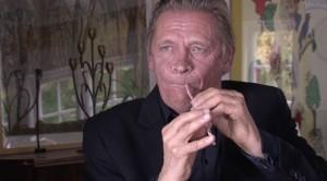 Danish musician Peter Bastian plays a straw flute